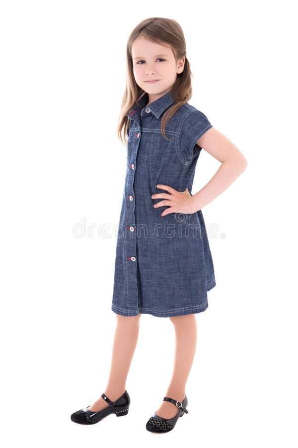 Cute little girl in denim dress isolated on white stock images