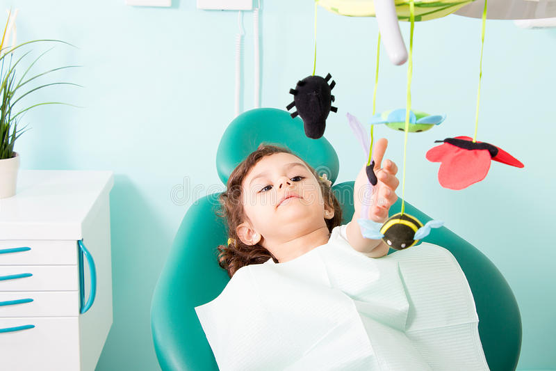 Cute little girl at dental clinic stock image