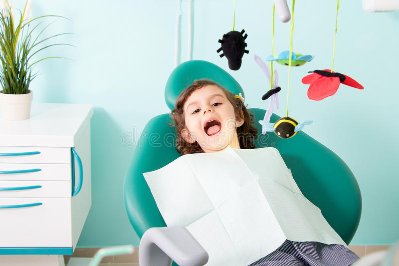 Cute Little girl at dental clinic royalty free stock images