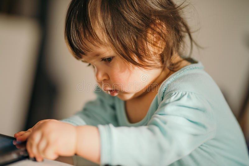 Cute little girl by doing stock images