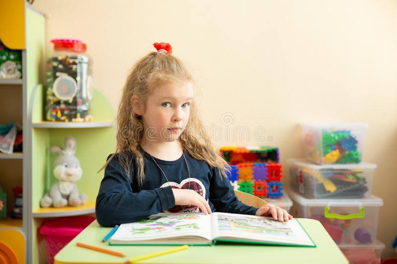 Educational Coloring Pages For Kindergarten : Cute little girl doing homework reading a book coloring pages