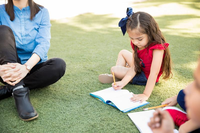 Little girl enjoying a class outdoors royalty free stock images