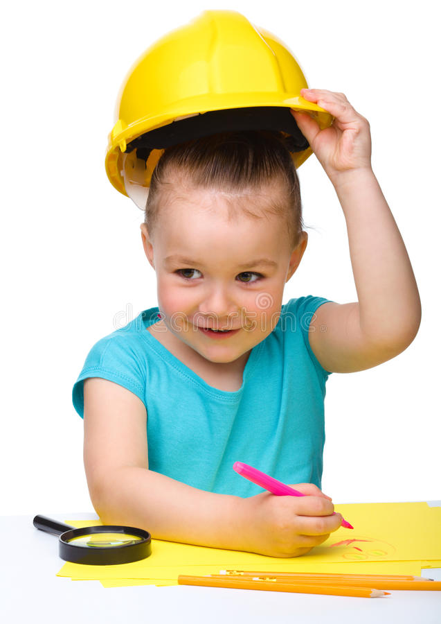 Cute Little Girl Draw With Marker Wearing Hard Hat Royalty Free Stock Images