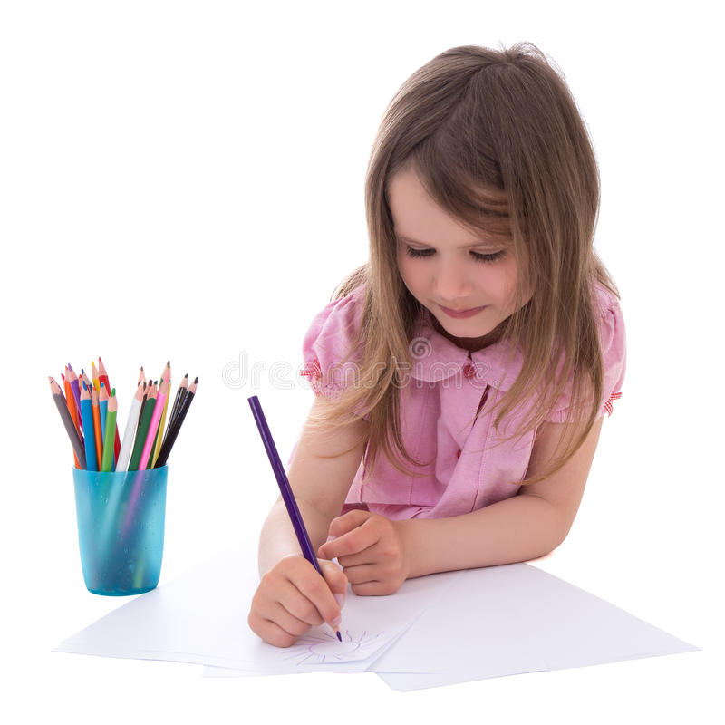 Cute little girl drawing with colorful pencils isolated on white stock image