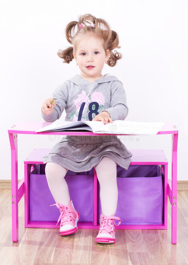Cute little girl drawing stock image