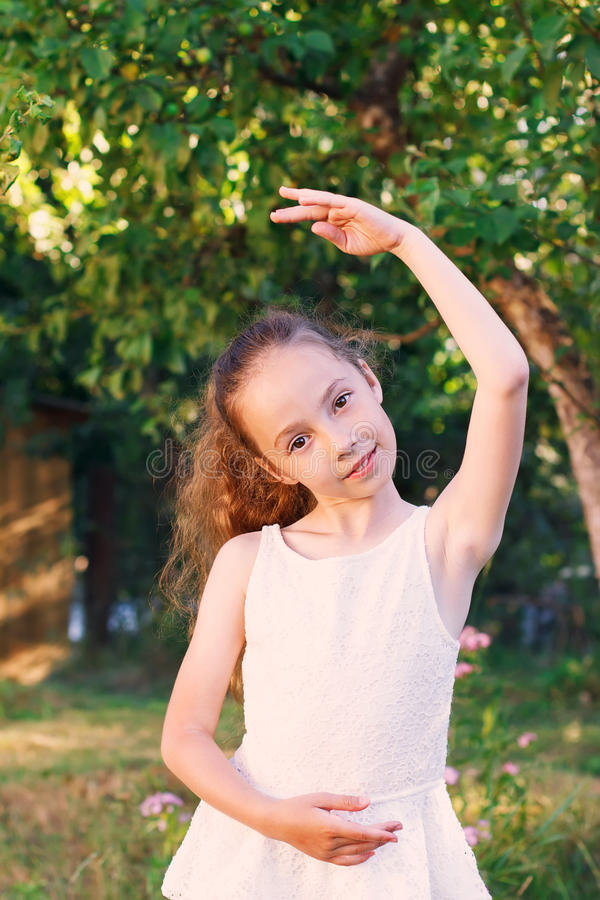 Cute little girl dreams of becoming a ballerina. Child girl in w royalty free stock image