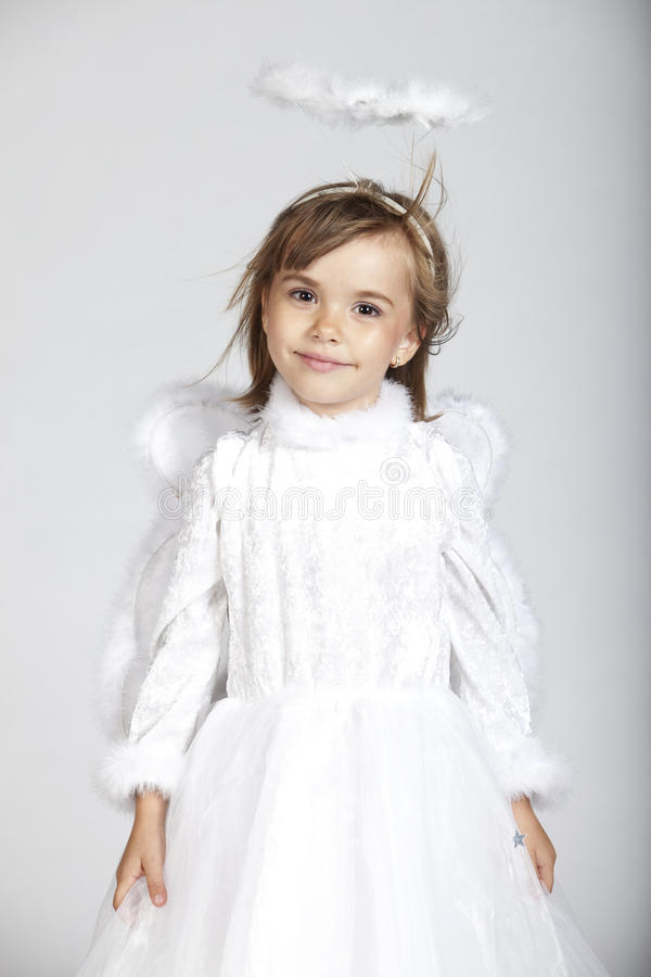 Cute little girl dressed as an angel royalty free stock photography