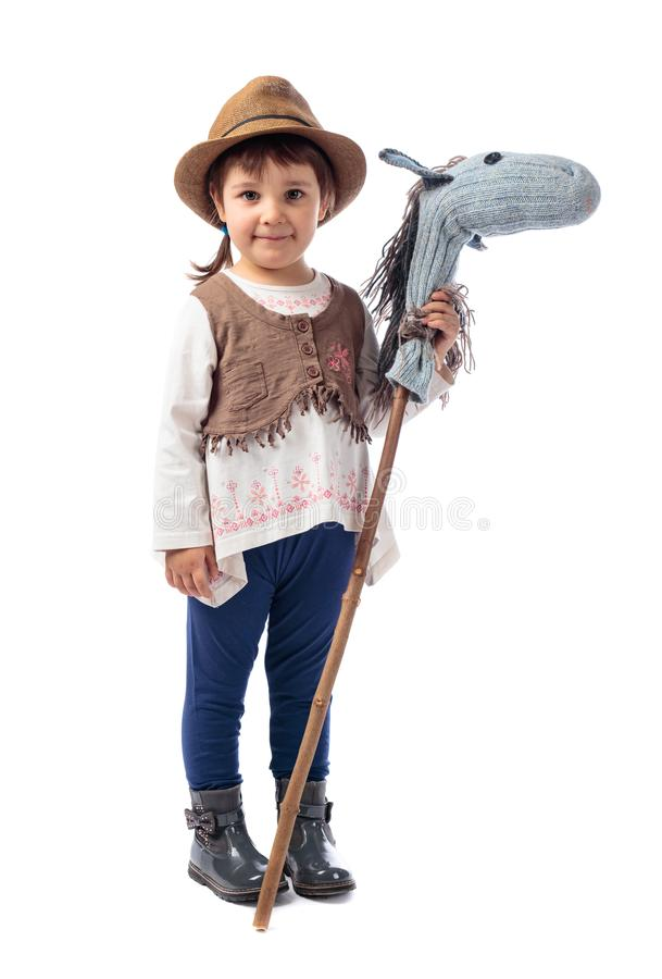 Cute little girl dressed like a cowboy playing with a homemade h stock photo
