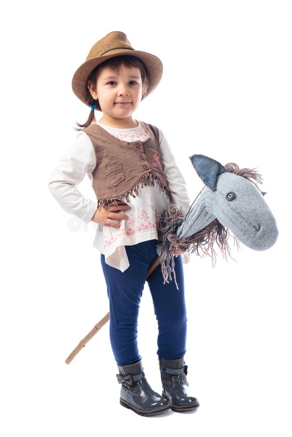 Cute little girl dressed like a cowboy playing with a homemade h stock photos