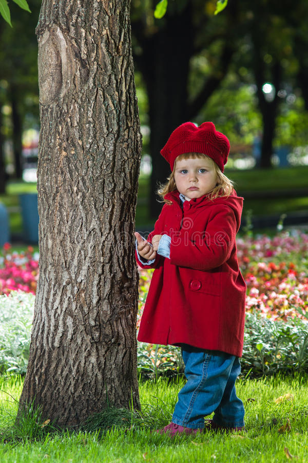 Download Cute Little Girl Dressing In Red Coat Stock Image - Image: 26559499
