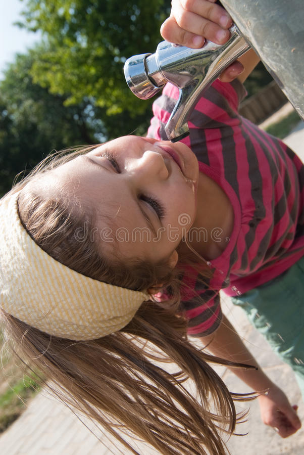 Cute Little Girl Drinking From A Fountain Stock Photo