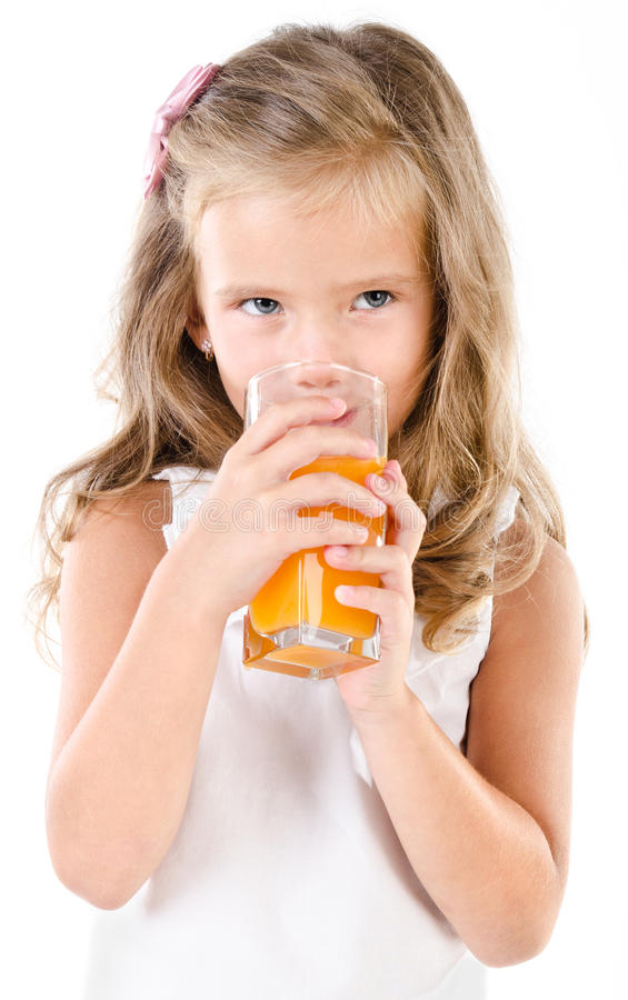 Cute little girl drinking orange juice isolated royalty free stock photography