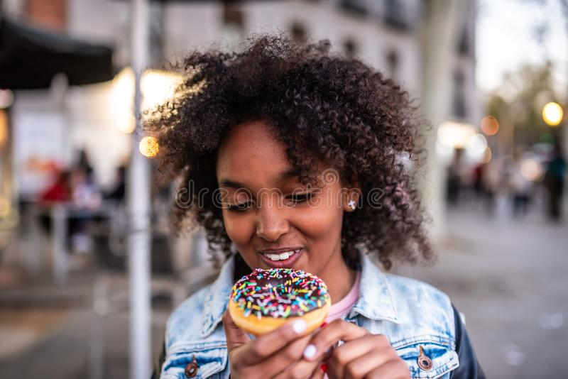 Cute Little Girl Eating a Donuts stock images