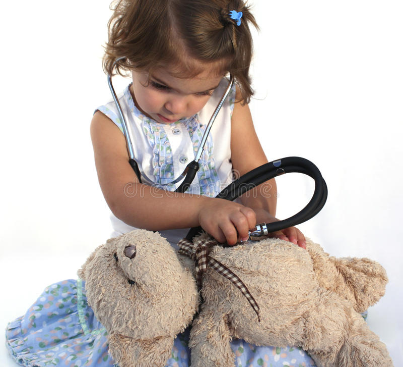 Free Cute Little Girl Examining Teddy Royalty Free Stock Image - 16304416