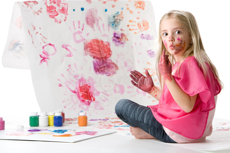 Cute little girl finger painting stock photography