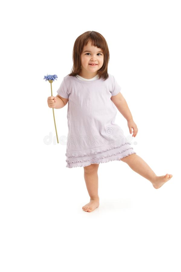 Cute little girl with flower stock photo