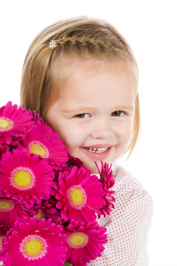 Cute little girl with flowers royalty free stock photo