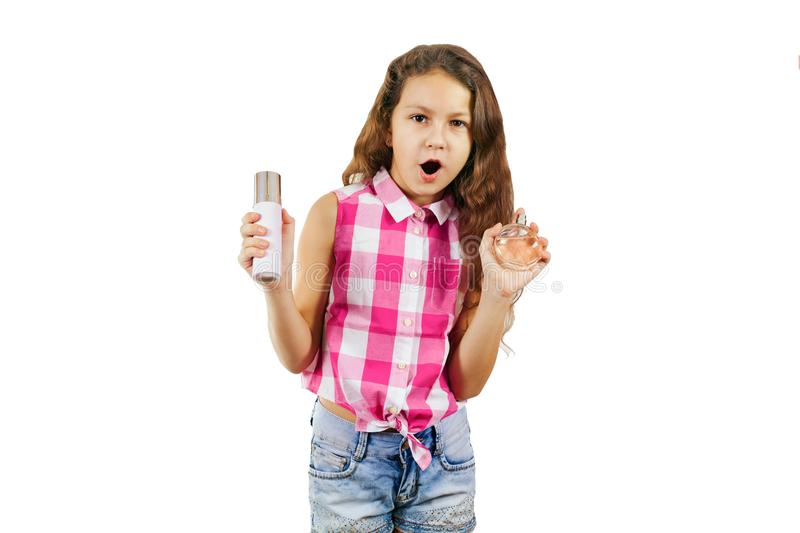 A cute little girl in the form of a glamorous diva with comb and. Eau de toilette - isolated on white background. Funny picture royalty free stock photos