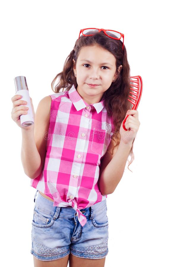A cute little girl in the form of a glamorous diva wearing red g. Lasses and with a comb - isolated on white background. Funny picture stock photo