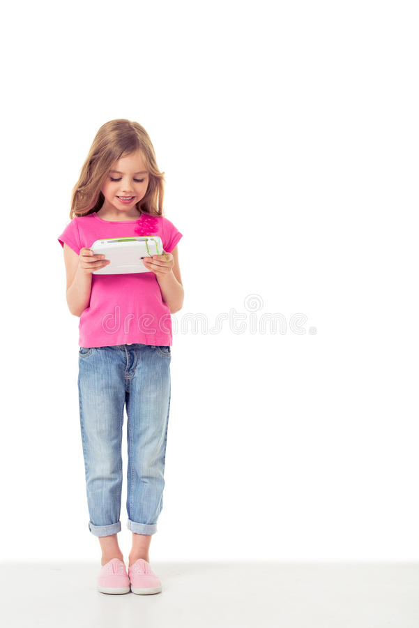 Cute little girl with gadget stock image
