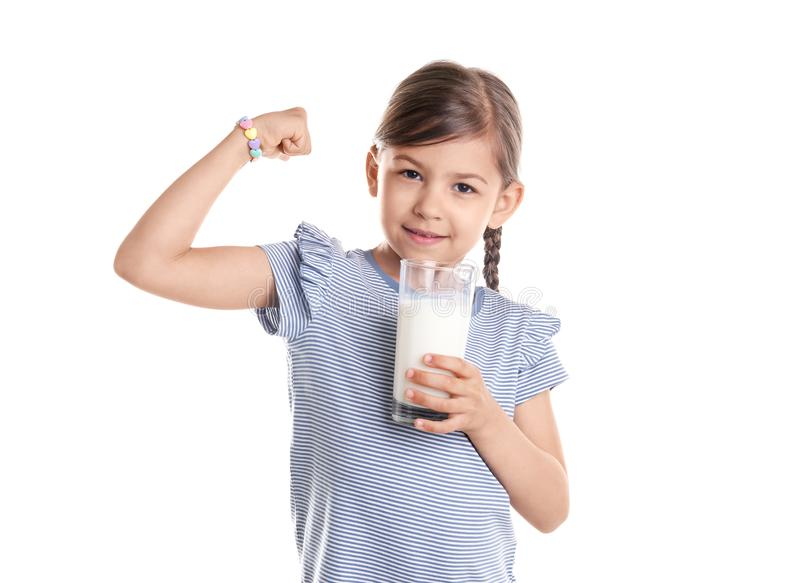 Cute little girl with glass of milk stock images