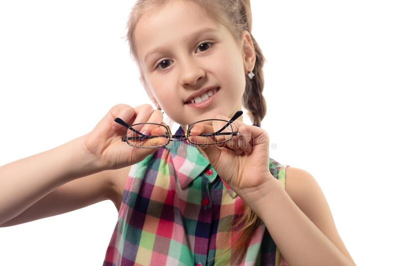 Cute little girl with glasses on white background royalty free stock photography