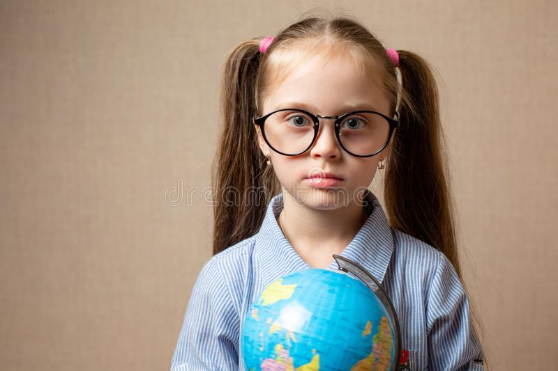 Cute little girl with globe. royalty free stock photography