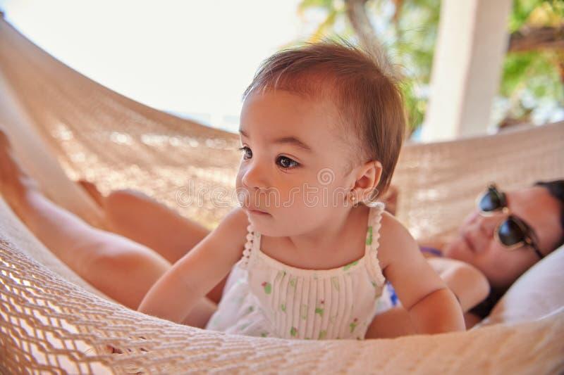 Cute little girl in hammock stock image