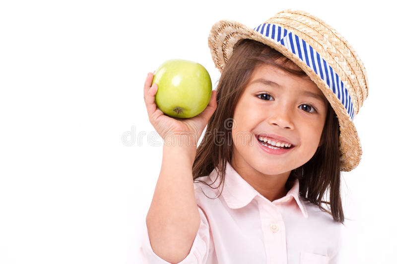 Cute little girl, hand holding green apple stock photos