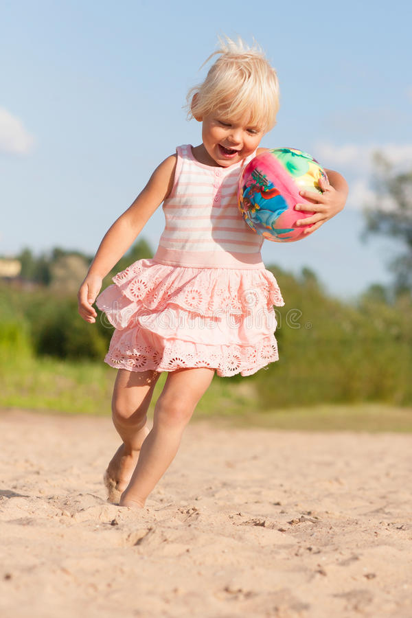 Download Cute Little Girl Having Fun On Beach Stock Photo - Image: 33059202