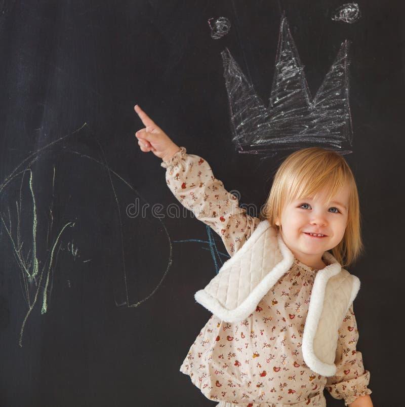 Cute little girl having fun stock photo