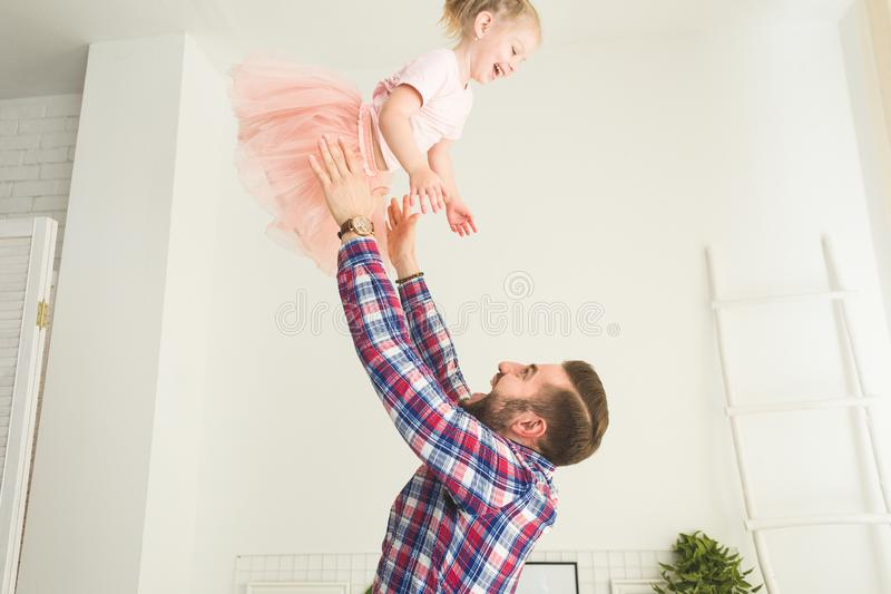 Cute little girl and her dad are having fun at home. royalty free stock photography