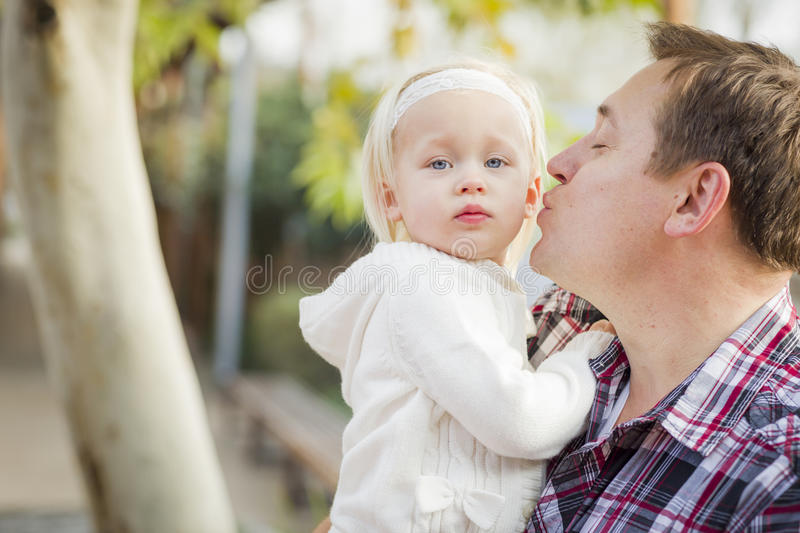 Cute Little Girl with Her Daddy Outdoors stock photo