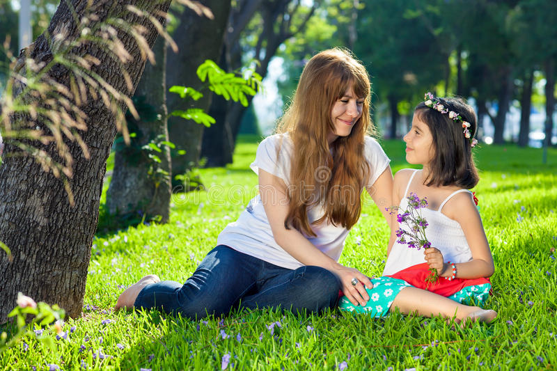 Cute little girl with her loving mother. stock image