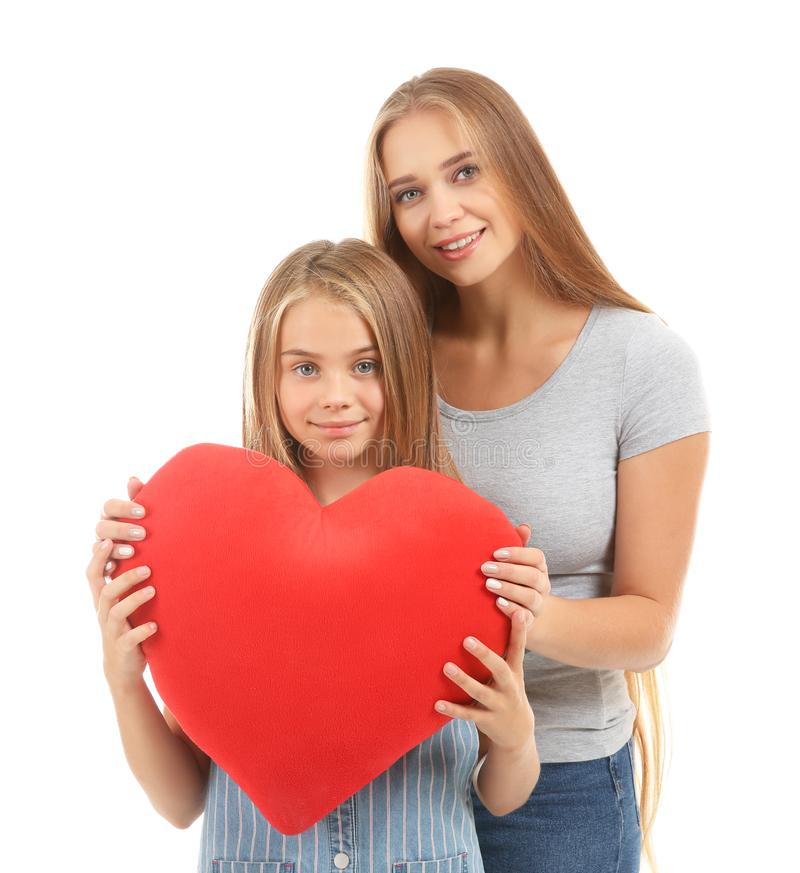 Cute little girl and her mother with big red heart on white background stock images