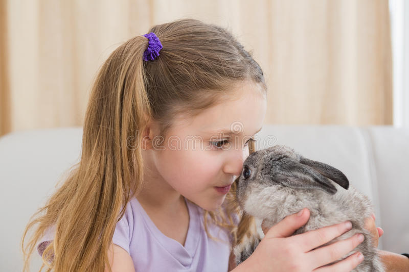 Cute little girl with her pet bunny stock images