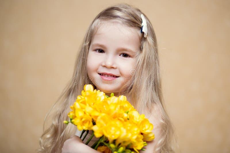 Cute little girl holding a bouquet stock photos