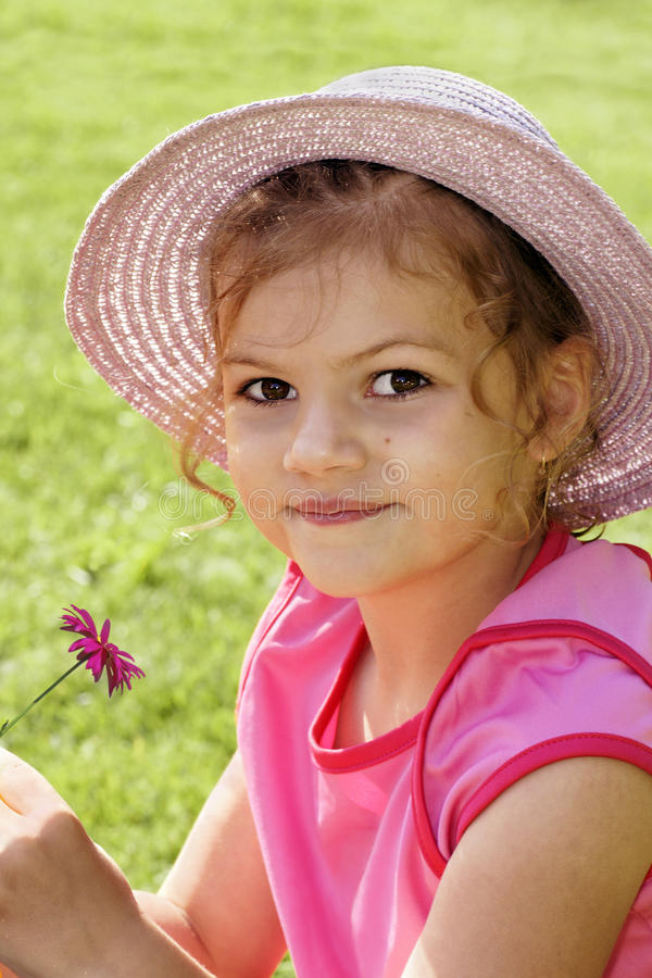 Download Cute Little Girl Holding Flower Royalty Free Stock Images - Image: 20772679