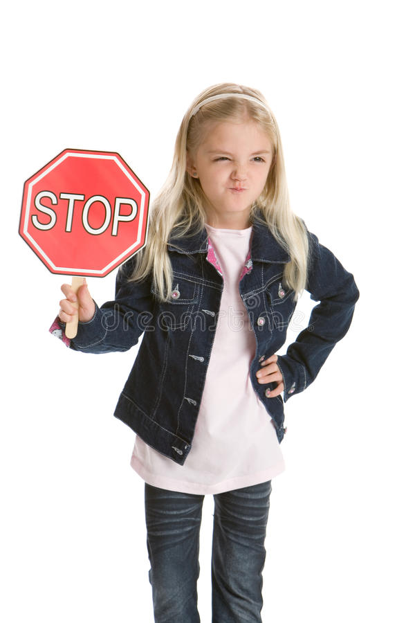 Cute Little Girl Holding A Stop Sign And Smirking Stock Image
