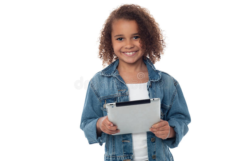 Cute little girl holding tablet pc stock photos