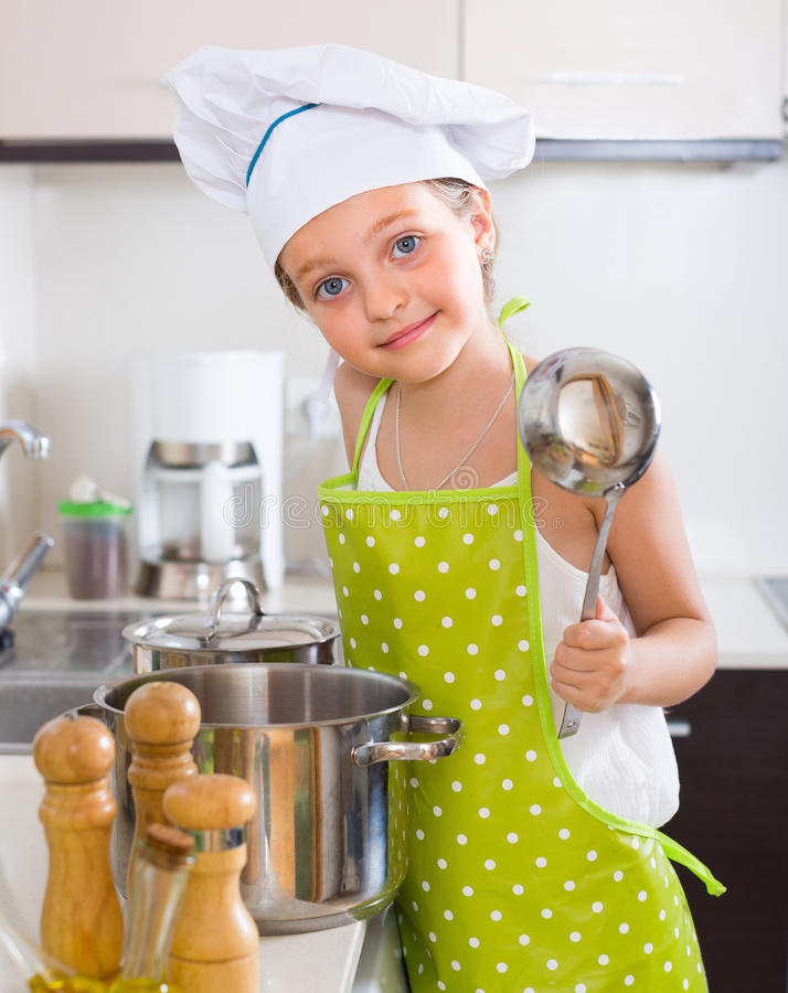 Cute little girl at home kitchen royalty free stock photos