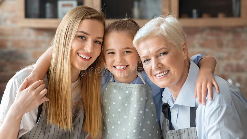 Cute little girl hugging her mom and granny royalty free stock image
