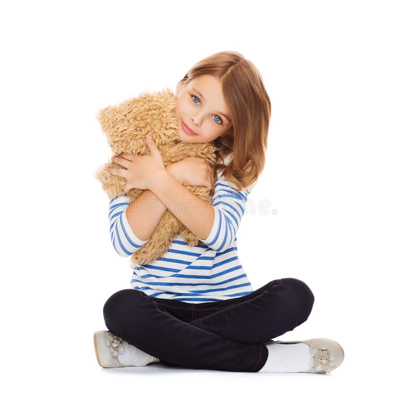 Cute little girl hugging teddy bear stock photo