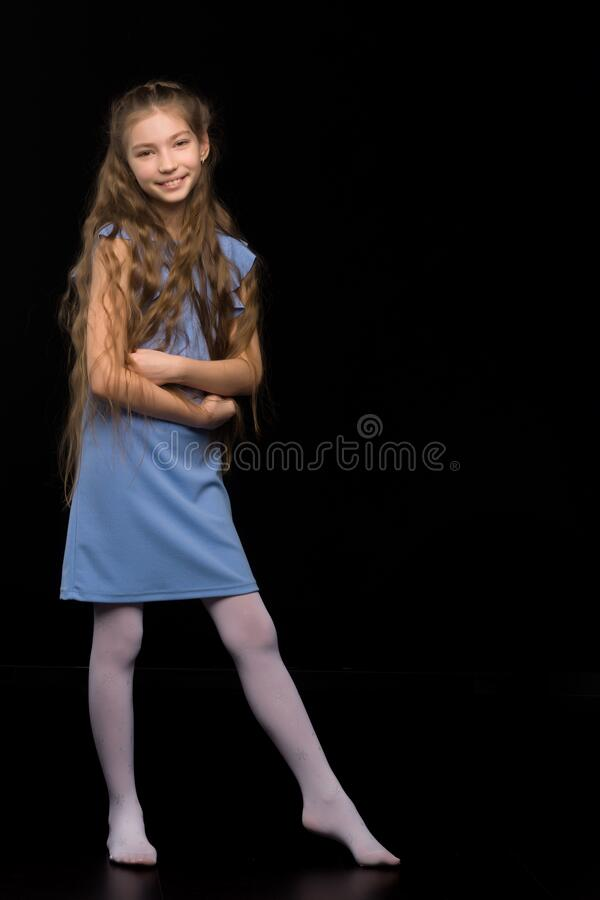 Free Cute Little Girl In A Beautiful Dress On A Black Background. Royalty Free Stock Images - 184104719