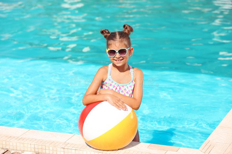 Cute little girl with inflatable ball stock photos