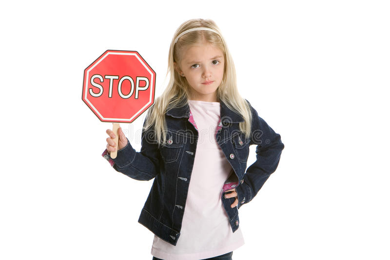 Cute little girl isolated, holding a stop sign royalty free stock photography