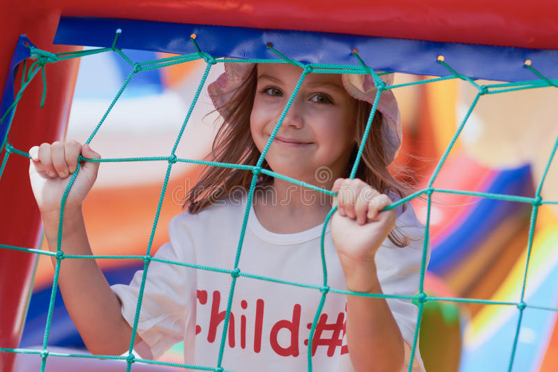 Cute little girl in a jumping castle stock images