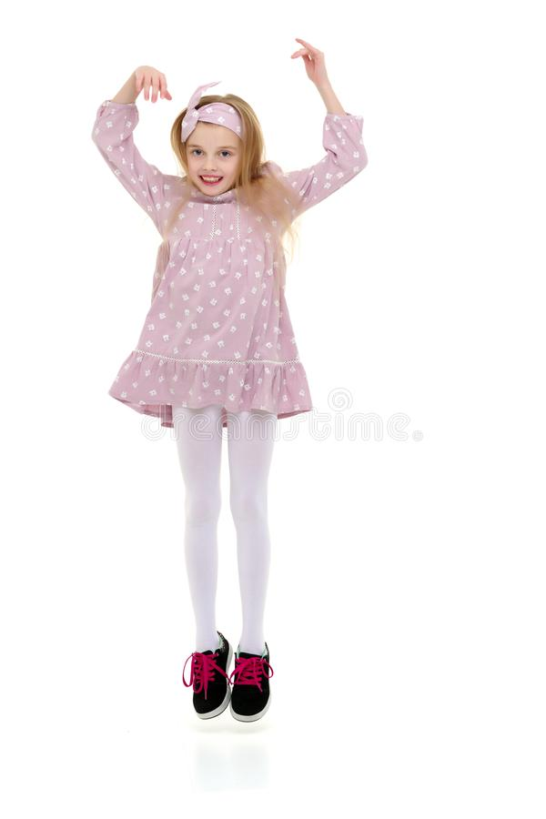 The little girl is jumping fun. stock image