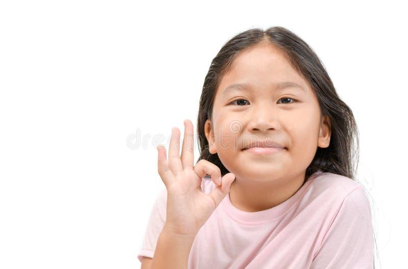 Cute little girl kid showing okay gesture royalty free stock images