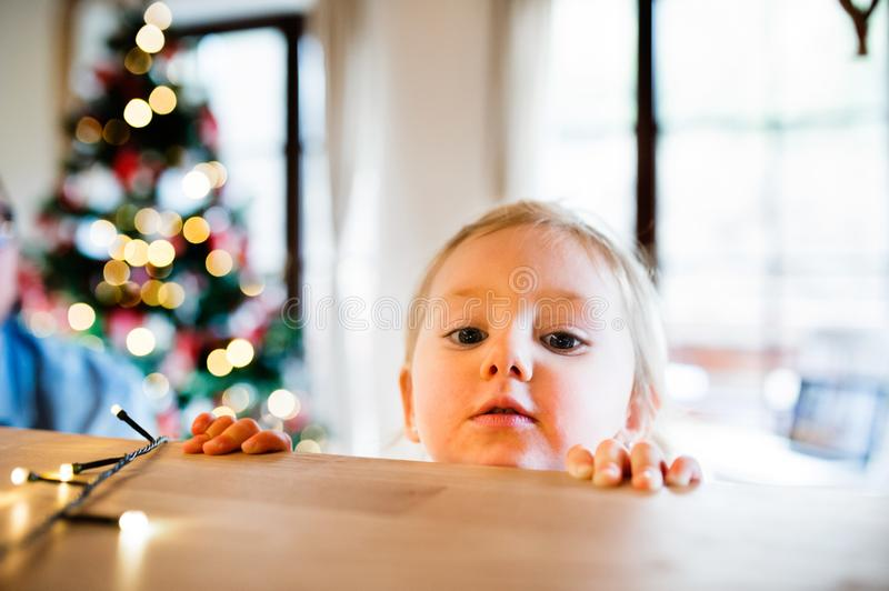 Little girl in kitchen at Christmas time. royalty free stock image